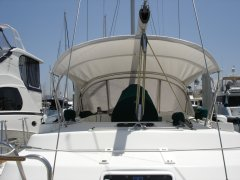 White bimini and dodger with a green pedestal cover